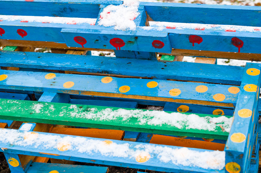 Colored bench Benches Blue Blue Color Close-up Colored Bench Day Green Color No People Outdoors Red Color Snow Wood - Material Yellow Color