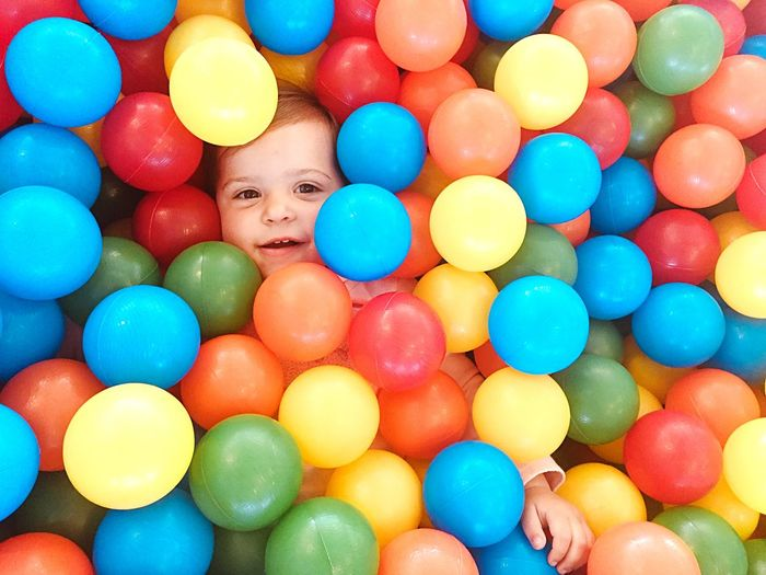 Drowned in a ball pool Toddler  Baby Candid Real People Multi Colored Childhood Large Group Of Objects Full Frame Child Abundance Ball Fun Indoors  Offspring People Leisure Games High Angle View
