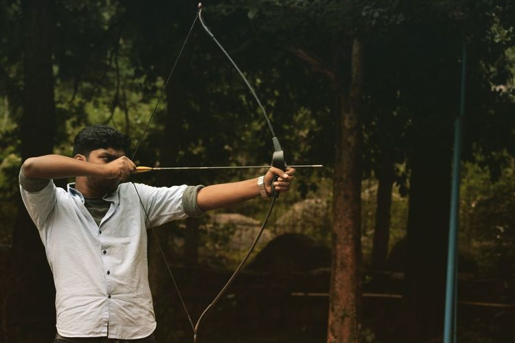 Man aiming with bow and arrow