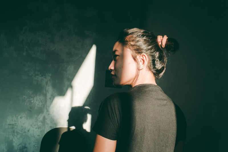 ASIA Alone Asian  Lights Rethink Things The Week On EyeEm Woman Day First Eyeem Photo Girl Girls Indoors  Light And Shadow Light And Shadows One Person People Portrait Real People Sad Sad & Lonely Sad Face Sadness Shadow Women Young Adult Fresh On Market 2017