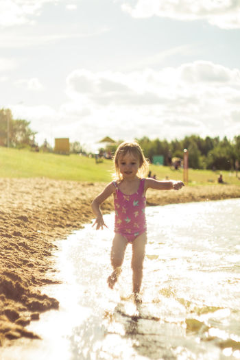 Child Childhood Cute Day Females Front View Full Length Girls Human Arm Innocence Land Nature One Person Outdoors Real People Sky Sunlight Water