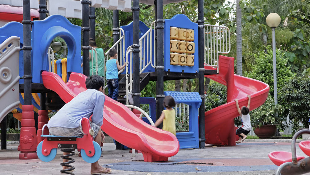 On a playing yard Morning Sunday Sparetime People Outdoors Day Childhood Park City Backgrounds Fun Kids Playground Playing Stories From The City Adventures In The City