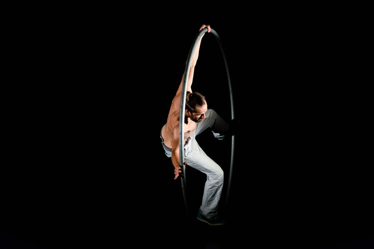 Circus Arms Raised Arts Culture And Entertainment Balance Beautiful Woman Black Background Copy Space Dancing Elégance Flexibility Full Length Healthy Lifestyle Human Arm Indoors  Lifestyles One Person Performance Skill  Studio Shot Women Young Adult Young Women