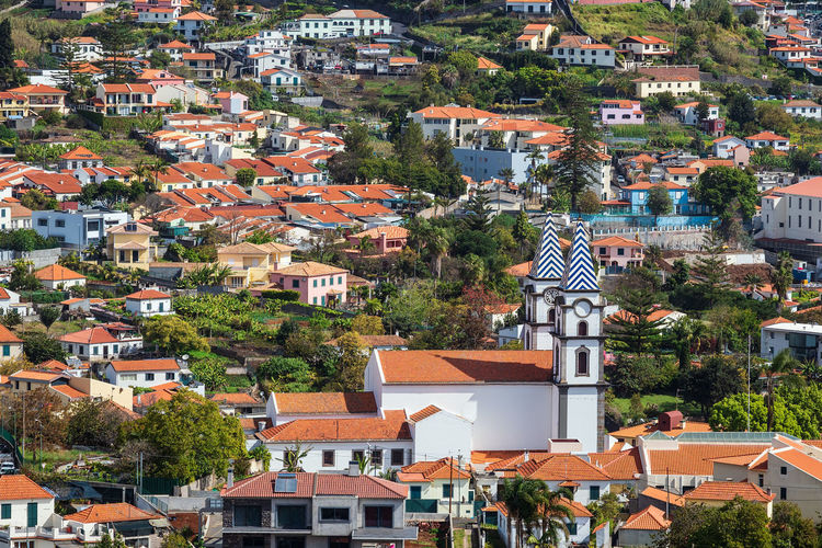 View to the city Funchal on the island Madeira, Portugal. Building Exterior Architecture Built Structure Building City House Tree Outdoors Cityscape Roof Day Church Place Of Worship Funchal Madeira Portugal Travel Destinations Travel Relaxation Vacation Tourism Nature Plant Town