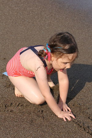 Playing With Sand At The Beach EyeEm Selects Child Childhood Full Length Girls Sand Beach