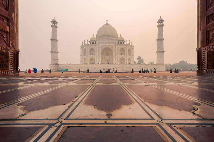 People in front of taj mahal during sunset