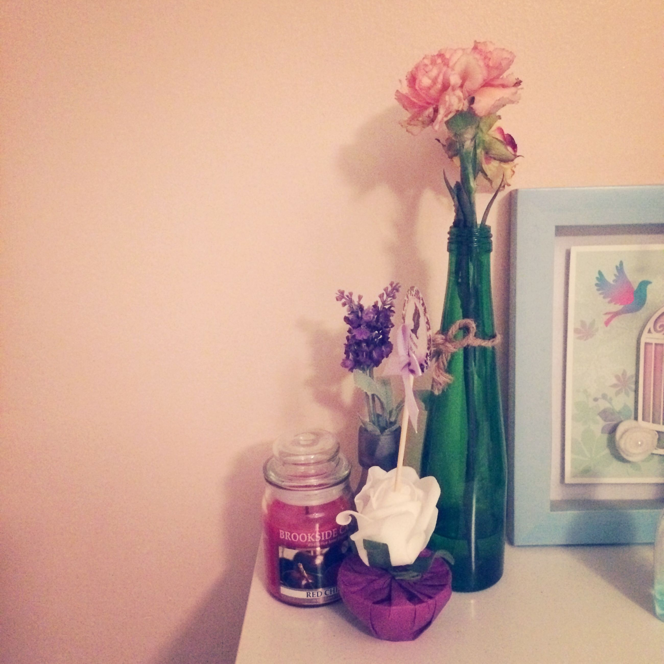 indoors, flower, vase, home interior, table, fragility, decoration, wall - building feature, potted plant, flower arrangement, freshness, still life, bunch of flowers, bouquet, petal, wall, close-up, pink color, flower pot, stem