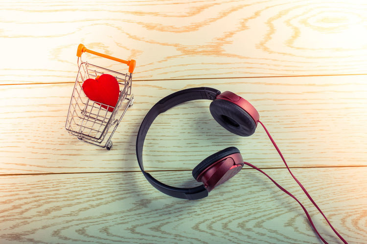 Headphones Headset Audio Background Black Cable Care Cart Concept Device Digital Earphone Earphones Entertainment Equipment Gadget Grocery Headphone Health Heart Love Market Marriage  Modern Music Red Retail  Romance Shop Shopping Sound Stereo Store Supermarket Technology Trolley Volume Wooden