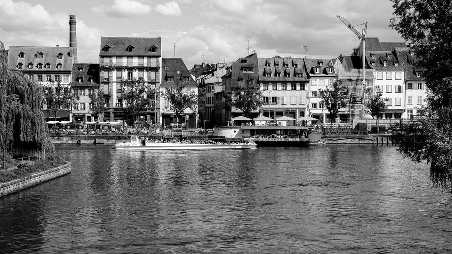 Boat People ... Urban Perspectives Black And White Street Photography Monochrome The Devil's In The Detail Black & White Water Architecture Building Exterior Built Structure Nautical Vessel Waterfront Transportation Cloud - Sky Sky River City Mode Of Transportation Nature Building Day Bridge No People Residential District Bridge - Man Made Structure Outdoors Passenger Craft Cityscape Travel Destinations
