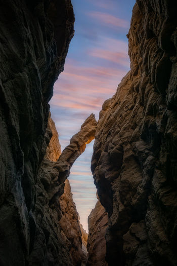 Rock formation against sky during sunset