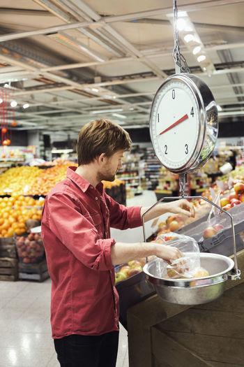 Man having food at market stall