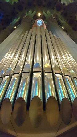 Inside the Sagrada Família Basilica Church Organ Pipes reflect Stained Glass Collours. Place Of Worship Fairytales & Dreams Architecture Modernisme in Barcelona, Spain