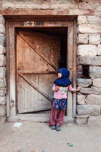 A Child of Turtuk, on the way to the border to Pakistan. Adult Adults Only Architecture Building Exterior Built Structure Childhood Children Day Door Doorway Full Length Islam Kashmir Ladakh Leh Lifestyles Old House One Person Outdoors People Real People Standing Turtuk Village
