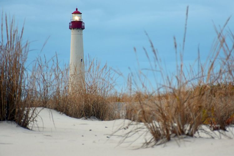 Lighthouse Guidance Direction Protection Safety Built Structure Architecture Tranquility Snow Cold Temperature Security Tranquil Scene Nature Building Exterior Clear Sky Travel Destinations Scenics Outdoors Tall - High Non-urban Scene