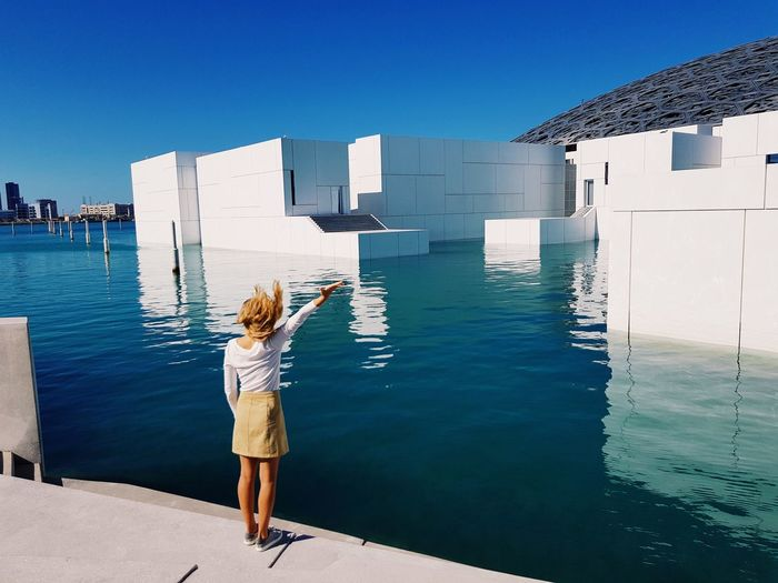 Freedom Flicking Hair Freedom Abu Dhabi Louvre Abu Dhabi Architecture Rear View Water Built Structure Building Exterior Real People Clear Sky