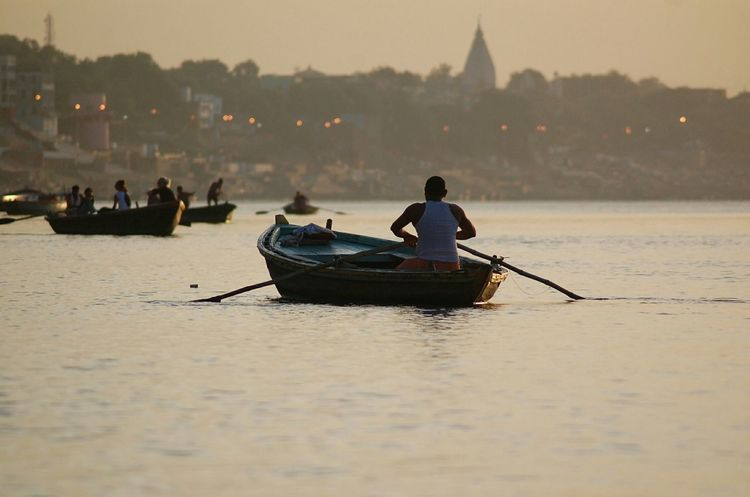 Good morning guys and have a brilliant day! 😊 Nautical Vessel Transportation Travel Mode Of Transport Water People Travel Destinations Outdoors Sunset Men Nature One Person Fog Tranquility Sunrise Holy Holyplace EyeEm Gallery Day India Varanassi Ganges EyeEm Best Shots EyeEm Eyeem Market