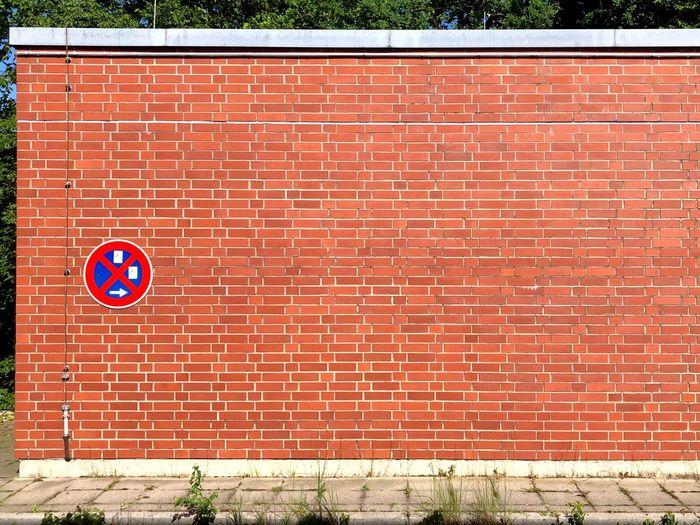 Road sign on brick wall