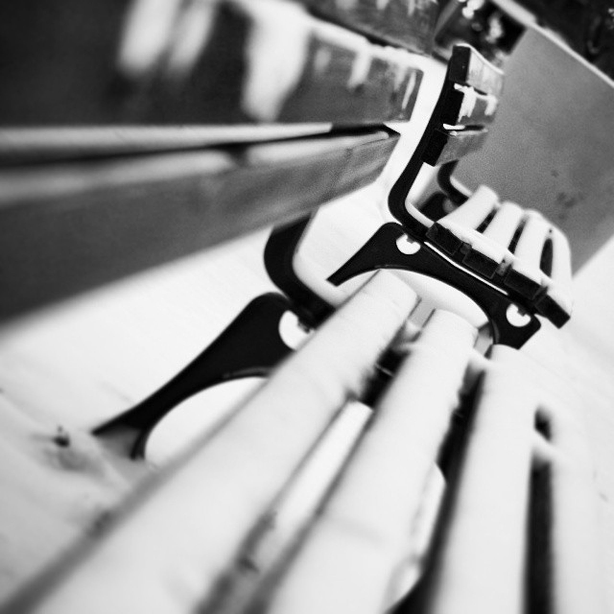 indoors, selective focus, close-up, focus on foreground, metal, music, musical instrument, metallic, arts culture and entertainment, shadow, no people, in a row, musical equipment, still life, part of, high angle view, pattern, technology, low angle view, day