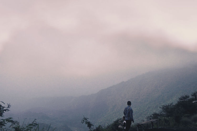 Fog Mountain Silhouette Tree Forest Nature One Person Pinaceae Adventure Outdoors Sky Beauty In Nature Landscape Darkness And Light Getting Inspired EyeEm Best Shots EyeEm Gallery EyeEm Masterclass EyeEm Best Edits Eye4photography  Sunlight Vacations Sea Rainbow Nature