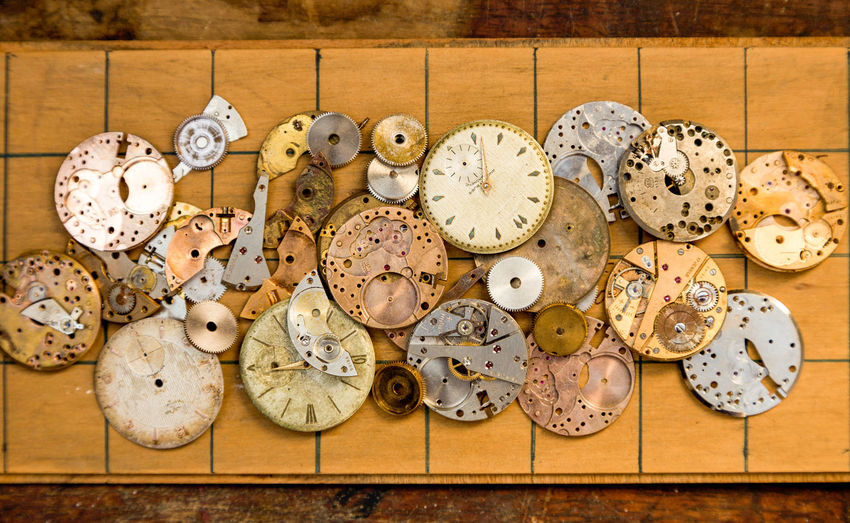 Close-up of clock on wood