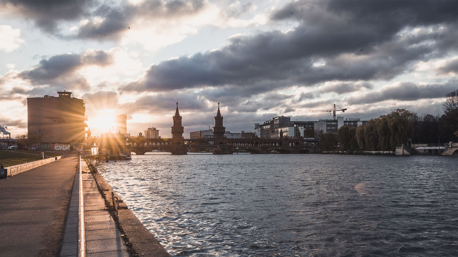 Oberbaum Bridge Over River Against Cloudy Sky During Sunset
