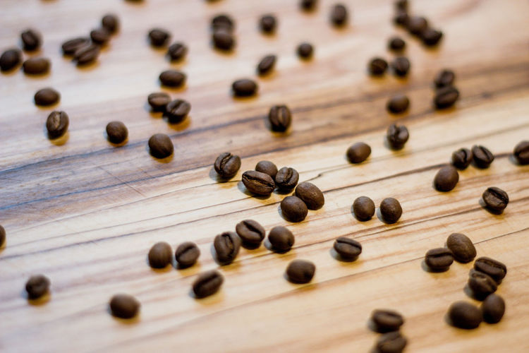Large Group Of Objects Wood - Material Selective Focus No People Close-up Indoors  Food And Drink Abundance Food Still Life Brown Coffee - Drink Table High Angle View Freshness Roasted Coffee Bean Studio Shot Coffee Leisure Games Colored Background Caffeine