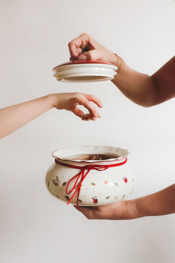 Christmas Christmas Decoration Christmas Cake Sweet Food Cakes Advent Bowl Porcelain  Childhood Child Christmas Bowl Creative Creativity Holding Hand Human Body Part Indoors  Human Hand Food And Drink Drink Studio Shot White Background Cup Refreshment Food People Container Hot Drink Lifestyles Mug Pouring Preparation  Tea Cup Holiday Moments