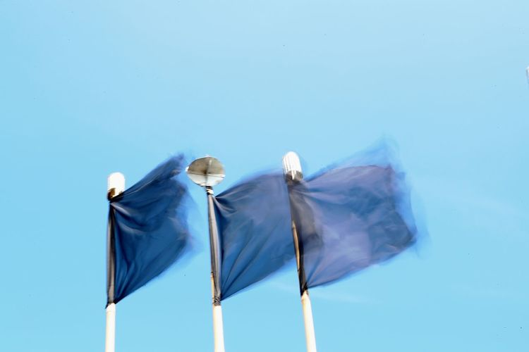 Signal Three Of A Kind Blue Clear Sky Close-up Day Flag Low Angle View No People Outdoors Sky Wind Windy Day