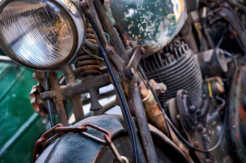 Close-up of old rusty motorcycle