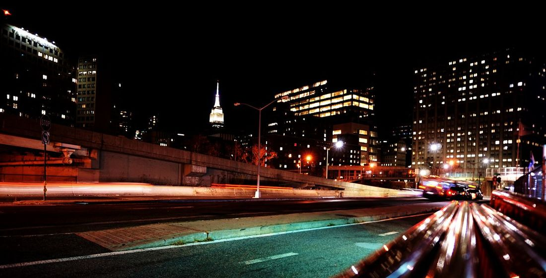 Light In The Darkness Nightphotography Illuminated Long Exposure Urban Skyline Light Trail Cityscape Building Exterior Street Light Urban Exploration Sonyalpha5000 Manhattan Manmadestructures Urbanphotography Office Building Exterior Geometric Architecture Empirestatebuilding FDR Drive See The Light Mobility In Mega Cities