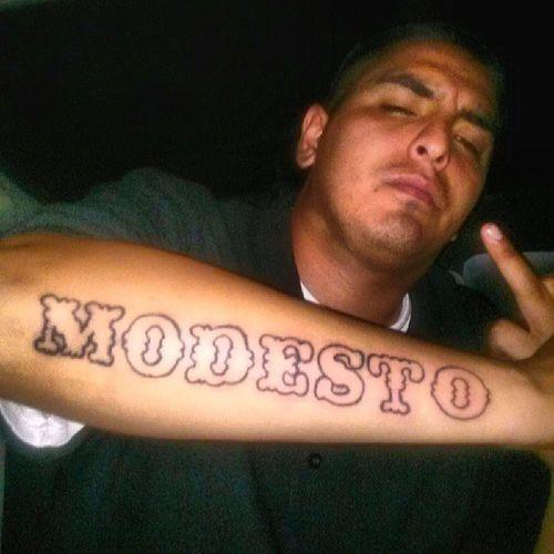 Jus got done tattin my boy @bennythefastgunna209 Modesto Freshink Tattoos Gettinprettygood Straightlines its halfway done i gotta put sum horizontal lines across the bottom and Stars