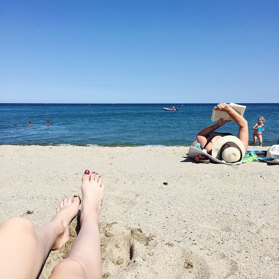 Ne rien faire. Beach Sea Human Leg Water Clear Sky Vacations Day Horizon Over Water Landscape Landscape_Collection Sea And Sky Seascape Leisure Activity Outdoors Nature Sky Human Body Part Holiday Summer Reading Beauty In Nature Beachphotography Weather Taking Photos Barcares