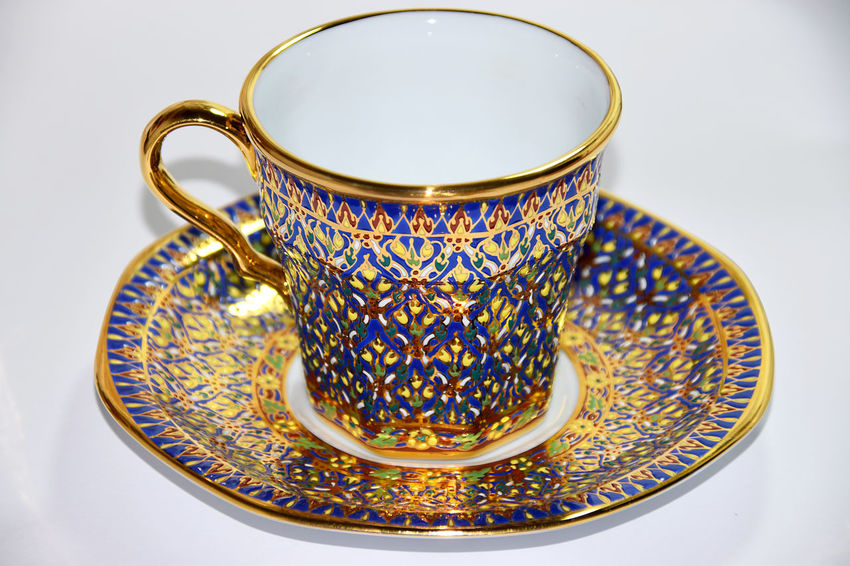 Thai Benjarong ceramic porcelain cup with hand paint texture Benjarong Gold Otop  Paint Porcelain  Set Tea Cups Textured  Thai Thailand Tradition Antique Art Ceramics Coffee Cup Cup Floral Pattern Indoors  Pattern Plate Product Of Thailand Still Life Studio Shot Tea Cup White Background