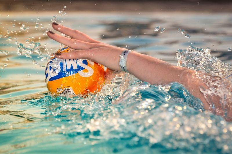 Person splashing water in swimming pool