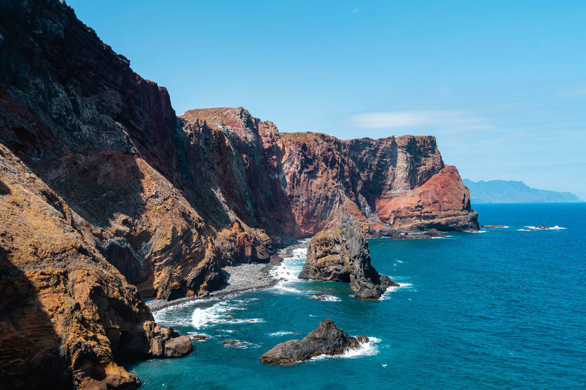 Madeira north coast line Madeira Island Beauty In Nature Cliff Cliffside Day Eroded Formation Idyllic Land Mountain Nature No People Non-urban Scene Outdoors Rock Rock - Object Rock Formation Rocky Coastline Scenics - Nature Sea Sky Solid Tranquil Scene Tranquility Water
