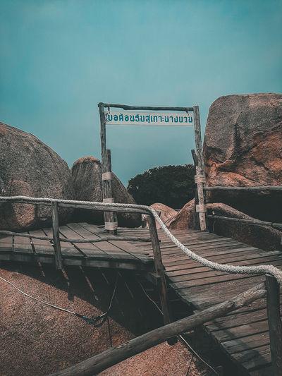 Abandoned railroad tracks against clear blue sky
