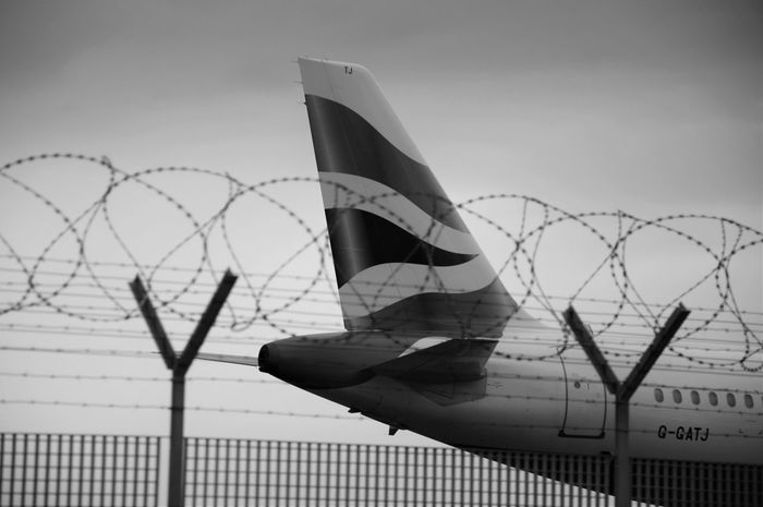 Airplane Barbed Wire Black And White British Airways Chainlink Fence Connection Cropped Environmental Conservation Fence Hanging Low Angle View Metal Metallic Modern Part Of Pattern Postprocessing Protection Safety Security Take Off Technology Transportation Vignette
