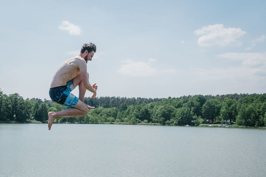 Hausboottour in Lindow / Brandenburg Friends The Great Outdoors - 2018 EyeEm Awards The Portraitist - 2018 EyeEm Awards The Traveler - 2018 EyeEm Awards Youth Beauty In Nature Boat Day Friendship Full Length Hausboot Jumping Leisure Activity Lifestyles Men Nature One Person Outdoor Outdoors Plant Real People Shirtless Shorts Side View Sky Tree Water Young Adult Young Men