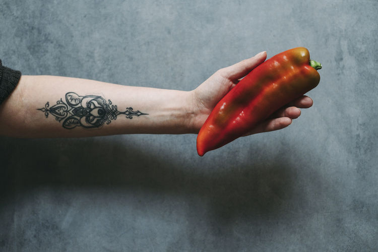 Cropped Hand Holding Red Chili Pepper