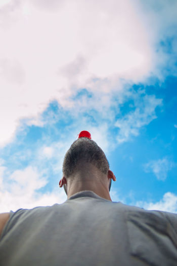 Rear View One Person Sky Men Headshot Cloud - Sky Leisure Activity Portrait Real People Lifestyles Day Low Angle View Nature Outdoors Relaxation Adult Casual Clothing Males  Human Body Part Clown Clown Nose