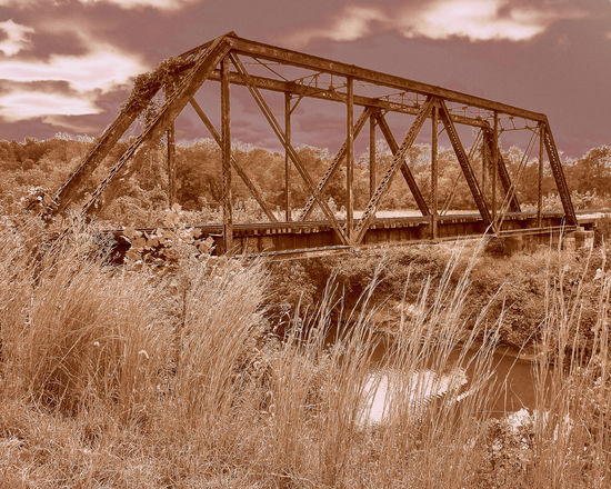 """""""Moonlight Crossing"""" a well-traveled, rusted railroad bridge found abandoned on a hike out through a weeded countryside. I wonder at the steam locomotives that crossed the creek here so many years ago. Abandoned Bridge Bridge - Man Made Structure Built Structure Countryside Damaged Design EyeEm Best Shots From My Point Of View Historic No People Nostalgia Old Outdoors Rural Scene Rusty Taking Photos The Past Train Tranquility Water Weathered Engineering Tranquil Scene"""