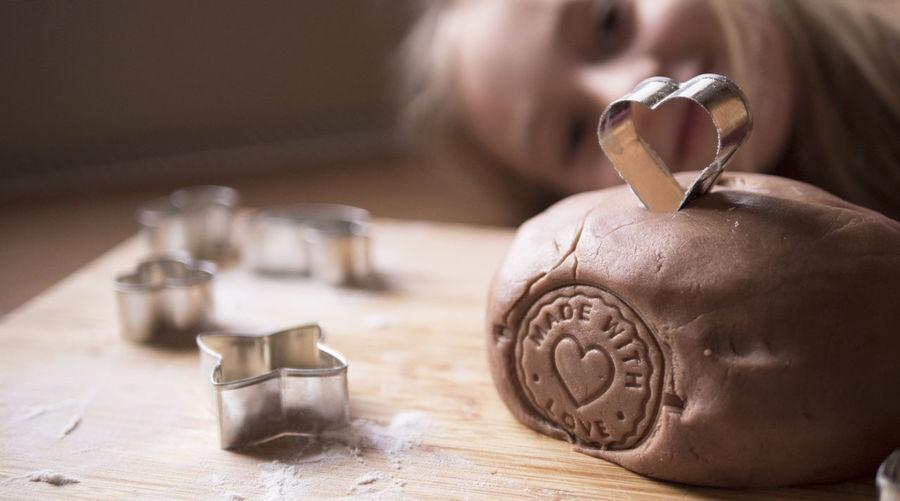 Close-up of girl preparing cookies