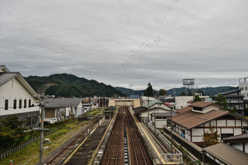 Architecture Building Exterior Built Structure City Cloud - Sky Day High Angle View Kiminonawa Mode Of Transport Mountain Nature No People Outdoors Public Transportation Rail Transportation Railroad Track Sky Train - Vehicle Transportation