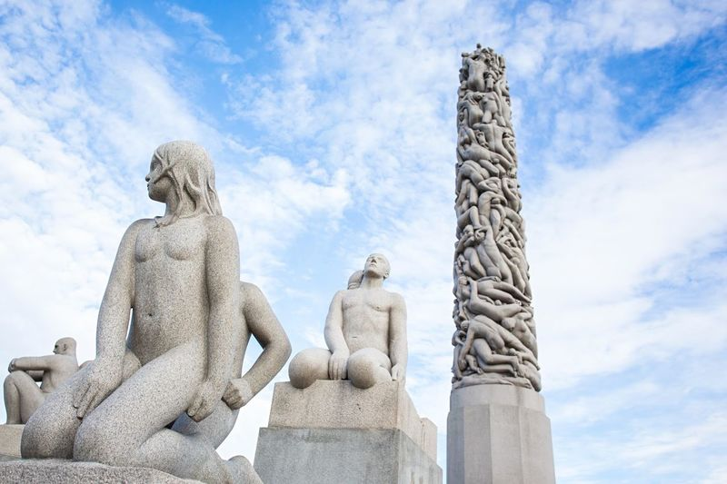Low Angle View Of Vigeland Sculpture Park Against Cloudy Sky