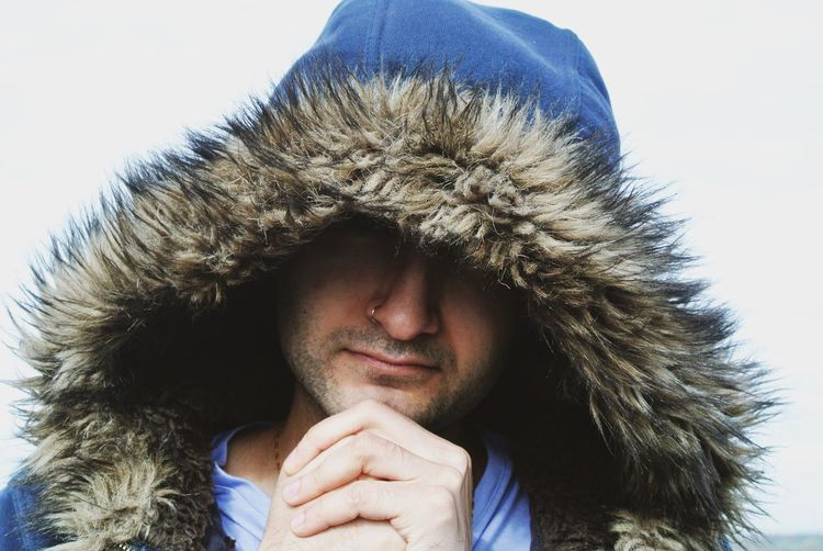 One Person Portrait Headshot Winter Cold Temperature Warm Clothing Front View Coat Looking At Camera Lifestyles Hood Sky Snow Fur Clothing Real People Close-up Hat Hood - Clothing Outdoors