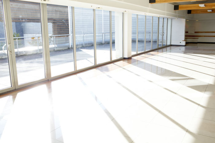 Sunlight Architecture Area Bright Building Business Commercial Construction Corridor Daylight Empty Floor Interior Metal Modern Office Perspective Shadows Shiny Through Urban