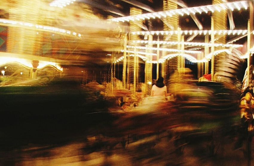 Lone figure on a Carousel in Paris Illuminated Night Carousel