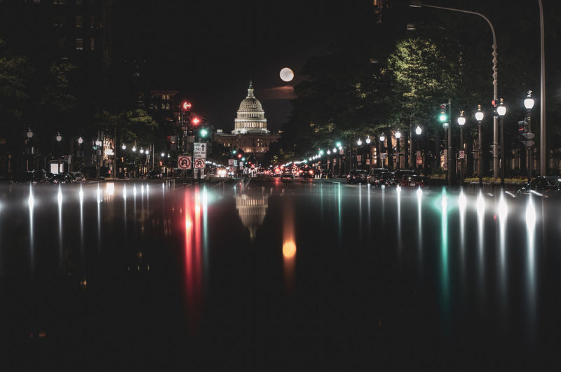 The Capitol in Washington DC Illuminated Night City Architecture The Capitol Capitol Building - Washington Dc Washington, D. C. Building Exterior Built Structure Water Reflection Waterfront No People Travel Destinations Building Nature Belief Tree Religion Lake Place Of Worship Sky Outdoors