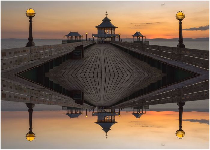 Clevedon Pier reflections EyeEm Selects Architecture Built Structure Sunset Sky Water Building Exterior History Nature Travel Destinations The Past City Lighting Equipment Orange Color Dome Street Light Travel Tourism Street Outdoors Spire