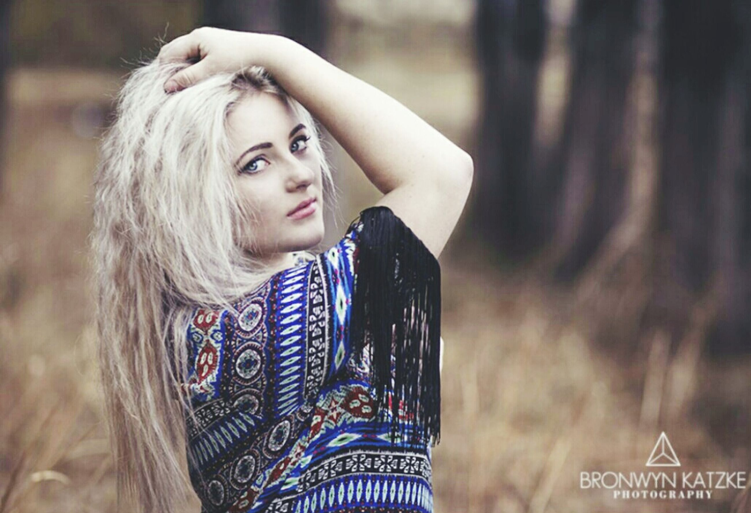 young adult, looking at camera, portrait, lifestyles, focus on foreground, person, front view, leisure activity, waist up, young women, smiling, casual clothing, standing, headshot, long hair, text, communication